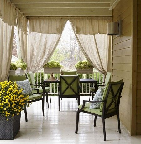 Outdoor drapery adds privacy when needed but keeps views open. The curtains are actually dropcloths from Canadian Tire, so no need to break the bank on outdoor fabric.