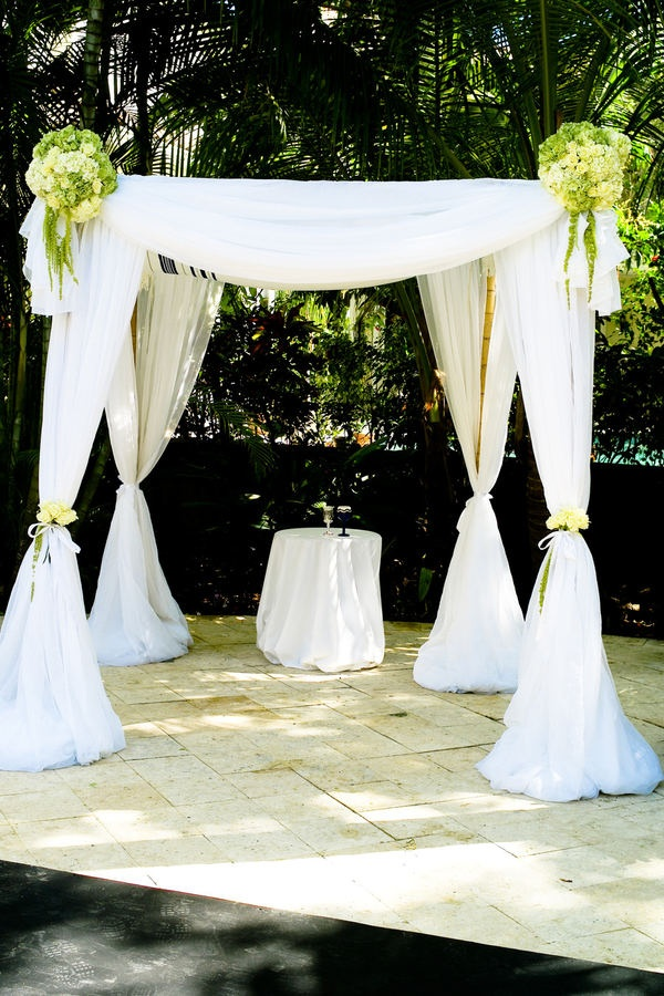 White and romantic Chuppah. Love it, in different colour flowers