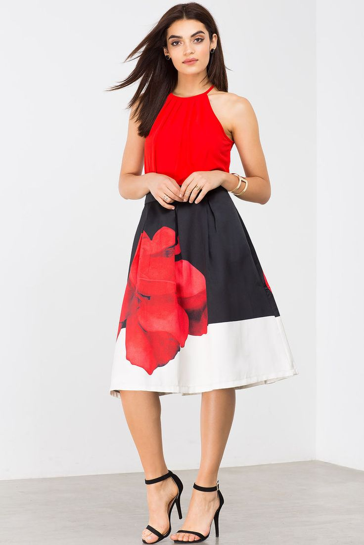 A romantic full midi skirt, featuring bold black-and-white colorblocking  and a popping bright red flower print at front and back.