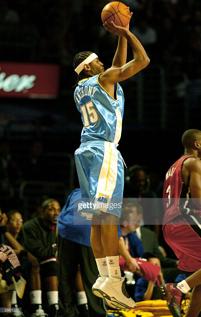 Carmelo Anthony #15 from the Denver Nuggets of the Rookie Team puts up a shot during the Got Milk? Rookie Challenge, part of the 53rd NBA All-Star weekend at Staples Center on February 13, 2004 in Los Angeles, California.
