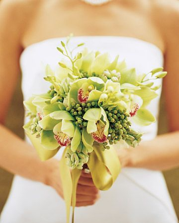 Nestled among pale-green brazilia and blush-pink tuberose are delicate dendrobium orchids and dramatic lime-green cymbidium orchids