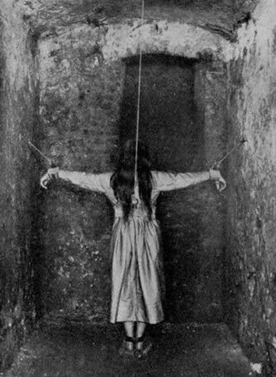 This is a mental patient in a Victorian mental asylum. They were imprisoned, chained or held in painful restraints, flogged and tortured in a variety of ways.