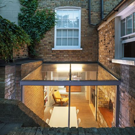 Sunken glass box extension added to heritage-listed London house.