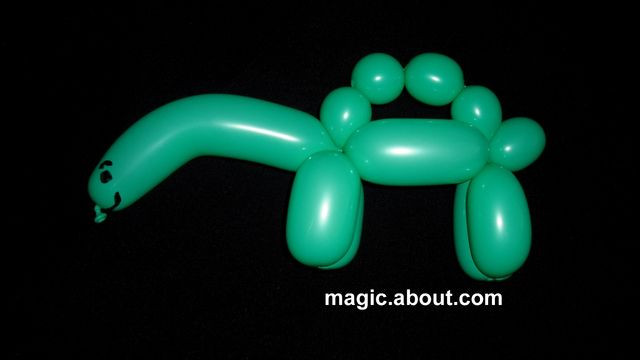 How to Make a Dinosaur Balloon in 5 Easy Steps - Here's a cute balloon animal that resembles a baby Stegasaurus. This one is easy to make from a single balloon. Just follow our step-by-step instructions and/or video. This one can be presented in different ways.
