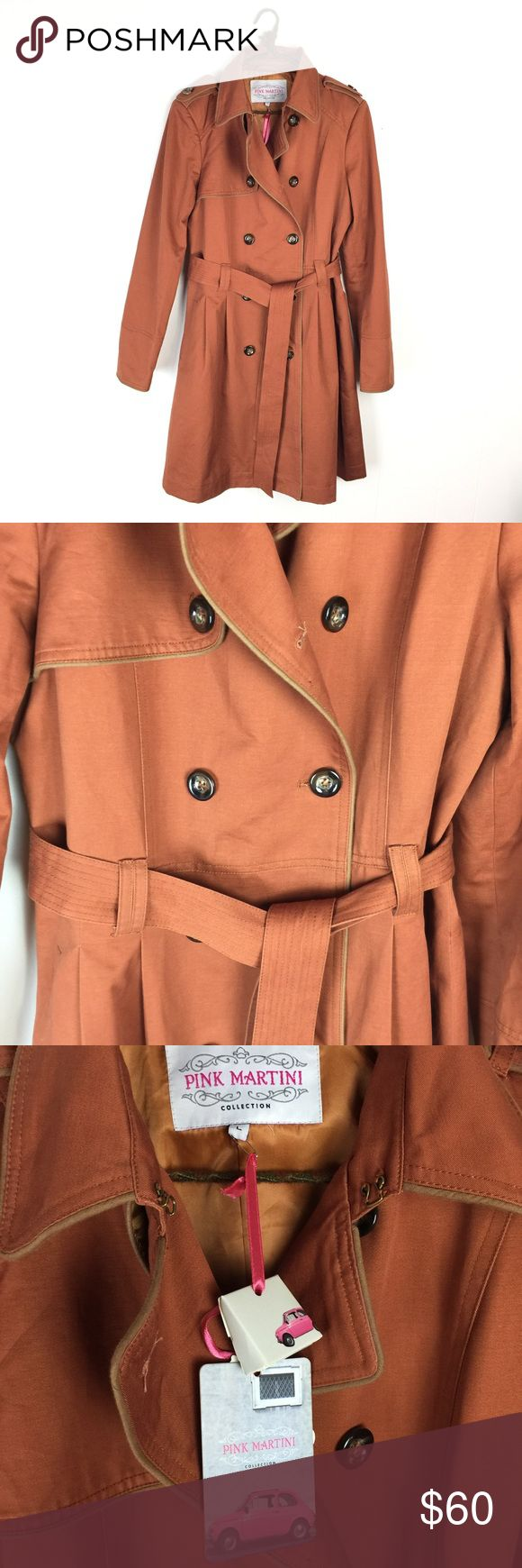 """Modcloth Pink Martini Retro Rust Trench Coat / L New with tags. Pink Martini Modcloth trench coat in rust orange/brown. Button front, tie waist. Cotton shell. Size large. Apx: 39"""" long. 21"""" underarm to underarm. Modcloth Jackets & Coats Trench Coats"""