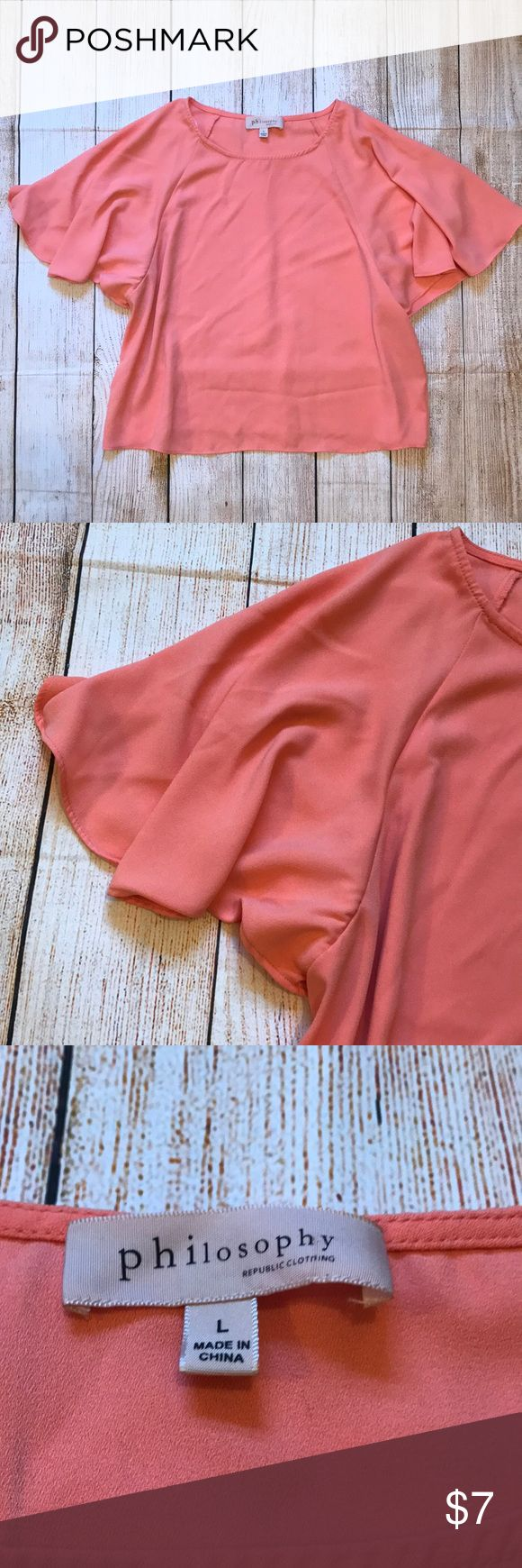 "Philosophy Flutter Sleeve Top Cute coral orange short sleeve top with oversized sleeves. Good condition, has small snag in material in the back of the shirt. 40"" Bust 19.5"" Long 100% Polyester Philosophy Tops Tees - Short Sleeve"