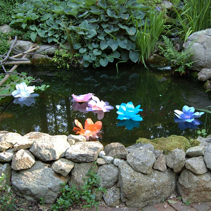 Floating Paper Lanterns add color by day and light into the night in a pool or pond.