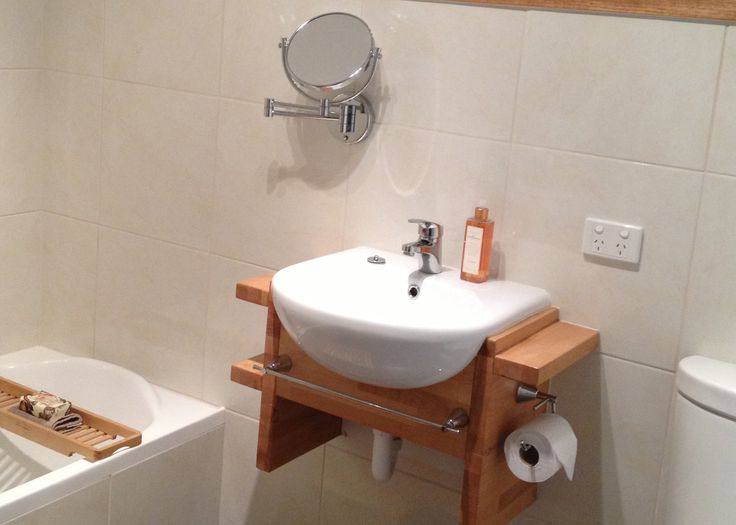 More bespoke woodwork, creating a unique wall-mounted basin vanity from a laminated oak off-cut.