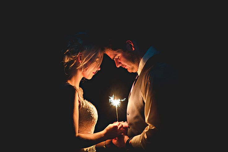 How beautiful is this single sparkler wedding photo?!