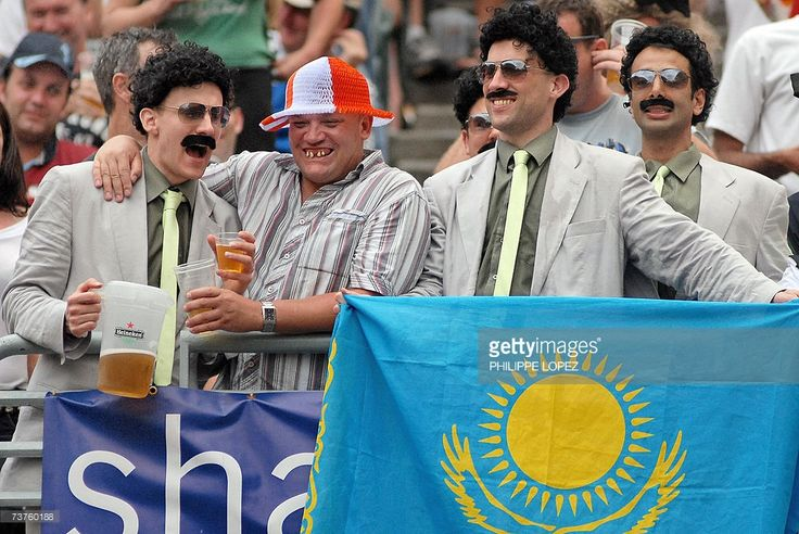 Supporters dressed as movie character Borat cheer while holding the Kazakhstan flag (R) during the Cathay Pacific Credit Suisse Hong Kong Sevens rugby tournament in Hong Kong, 01 April 2007. Since the first tournament in 1975, the Hong Kong Sevens has grown into a major sporting event that makes up part of the International Rugby Board's annual sevens competitions.