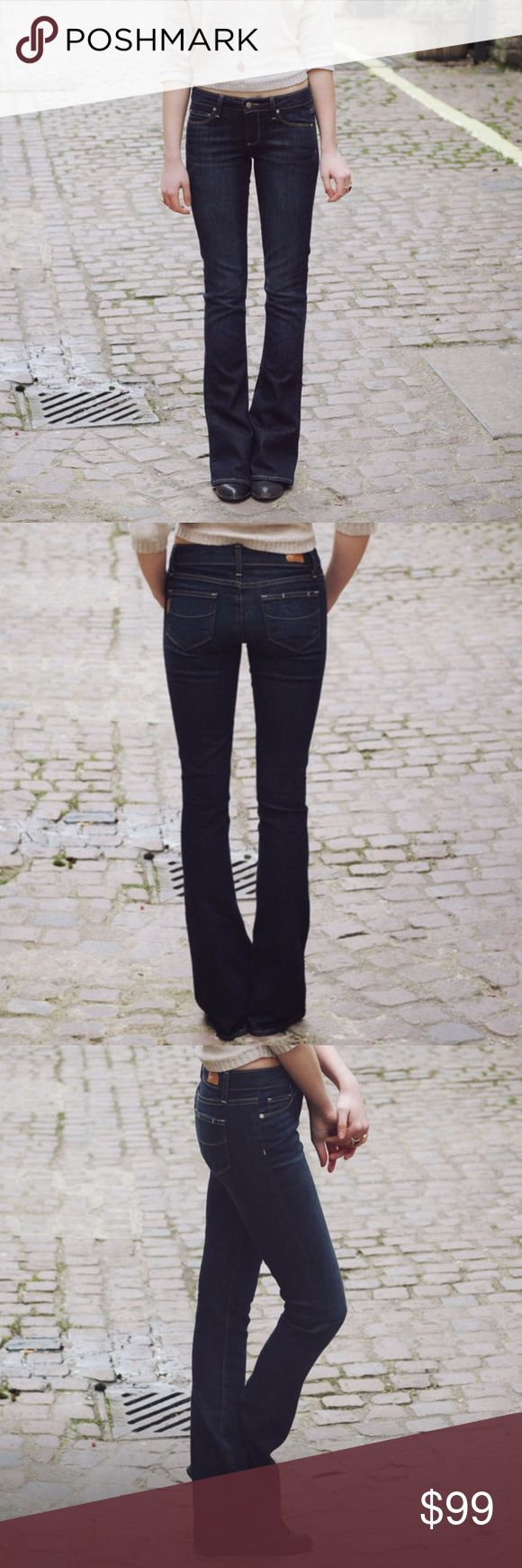 """Paige Lou Lou Tulip Flare These petite flare jeans feature 5-pocket styling and a single-button closure. Stitching at back pockets. Mild distressing. 20"""" leg opening. 27 x 32. Paige Jeans Jeans Flare & Wide Leg"""