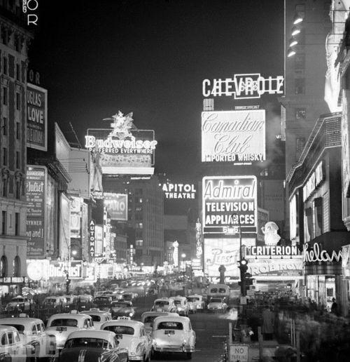 Signs illuminate traffic on Broadway towards Times Square. New York, 1954.    Photo byAndreas Feininger for LIFE Magazine.    #life #magazine