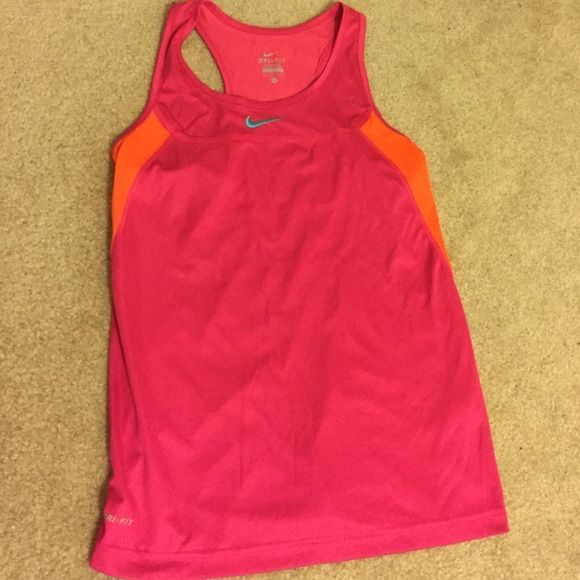 NIKE workout tank top! Never worn! Pink tank top with orange panels on the side and back! Dri-fit! Never worn--bought it and thought I was going to wear it so I took the tags off but never did Nike Tops Tank Tops