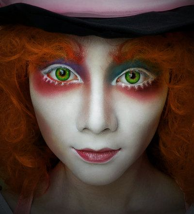 The Mad Hatress.  Piercing green eyes outlined with white; dusted with hues of blues,reds, and purples.  Hatte 020 by Jeahny on DeviantArt