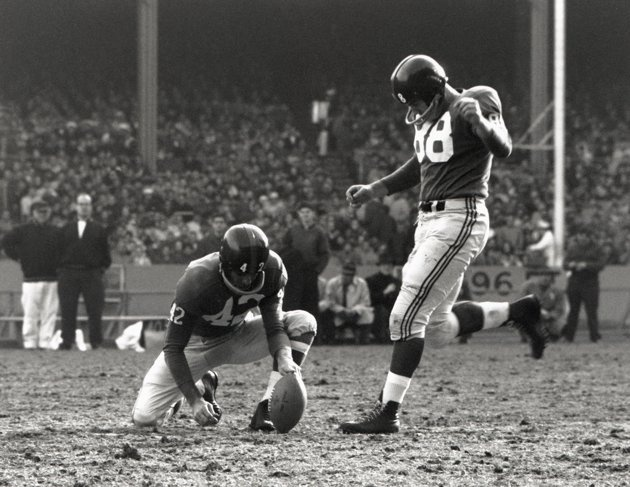 BRONX, NY - CIRCA 1958-61: Pat Summerall #88 of the New York Giants kicks and Charlie Conerly #42 holds during a game at Yankee Stadium in the Bronx, New York. Summerall played for the Giants from 1958-61. (Photo by Robert Riger/Getty Images)