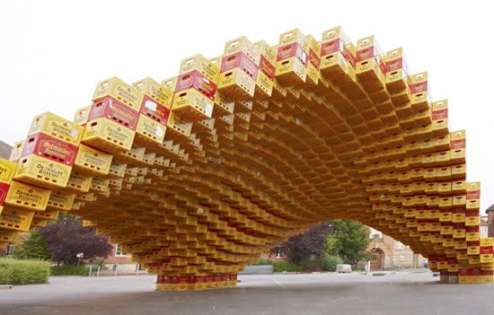 Boxel is an experimental pavilion designed and built by students of the architecture of the university of applied sciences in detmold, Germany.The pavilion has the shape of a minimal surface and it has been built with more than 2.000 beer boxes placed all over the surface form.    The task for the student was to construct a 1:1 scale summer pavilion using digital design and fabrication tools.The pavilion was designed using a parametric design software to populate and control the position of…