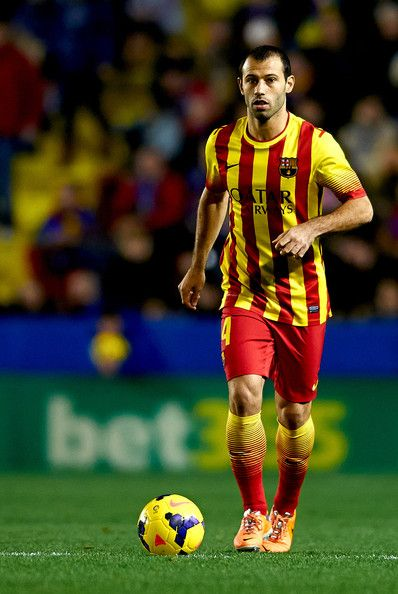 Javier Mascherano of Barcelona runs with the ball during the la Liga match between Levante UD and FC Barcelona at Ciutat de Valencia on January 19, 2014 in Valencia, Spain.