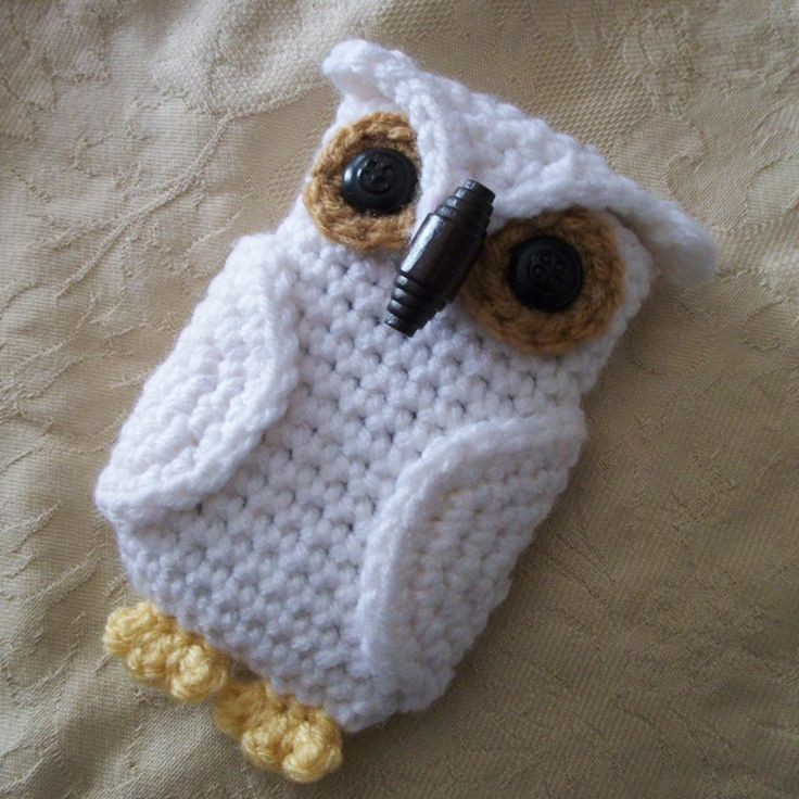 Hedwig the Owl cell phone case I made with [REAL] vintage button eyes and wooden toggle button closure.