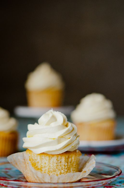 Mango Cupcake filled with mango curd and topped with mango buttercream