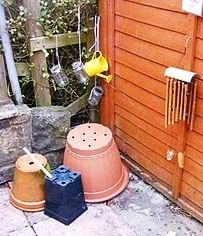 Outdoor music play. How simple this is, to repurpose ordinary things you would find garden as musical instruments.