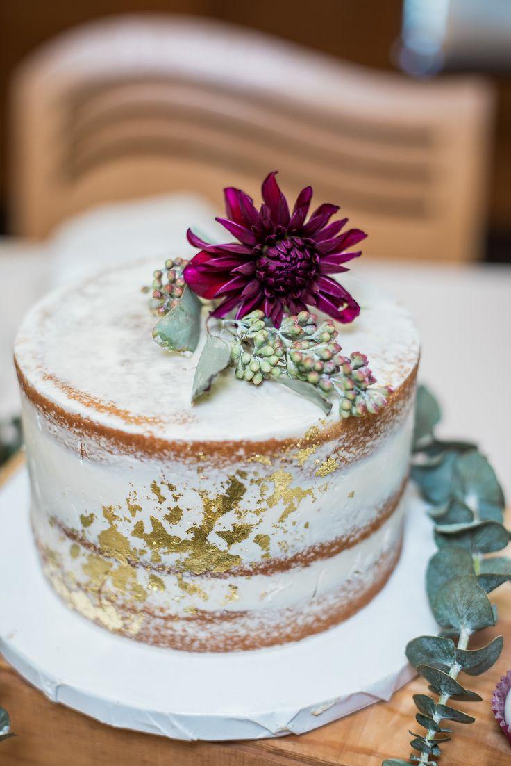 Winter wedding cake designed by Cocoa & Fig. Floral decor designed by Minneapolis wedding florist Artemisia Studios. Photo by Iris Studios Photography (https://www.irisstudiosphoto.com/) #wedding #weddingcake #flowers #floral #floraldecor #weddinginspiration #winterwedding #minnesotaweddingflorist #minneapolisweddingflorist #artemisiastudios