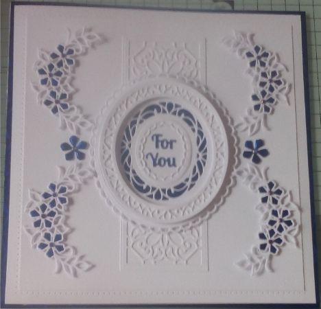 """I used the ornate octagon striplet die with the petite peony and the new Grace die for this card, it is quite large (8 x 8""""), but I really like the effect."""