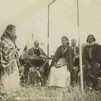 "Métis sitting around table during  North-West ""Half-Breed"" Commission, Devil's Lake,  1900"