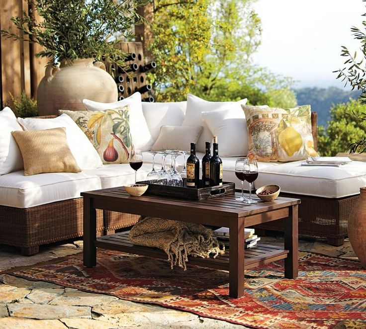 solid white outdoor cushions and dark wood table design above rug also stones floor