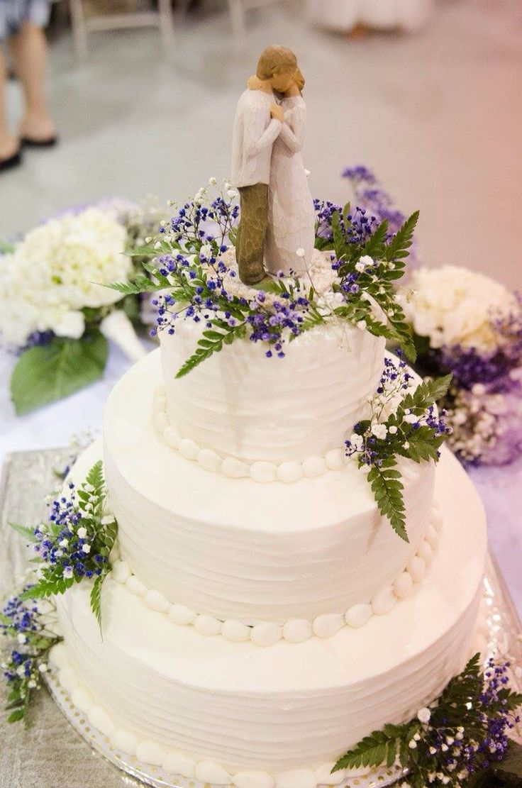 Wedding cake with willow tree cake topper