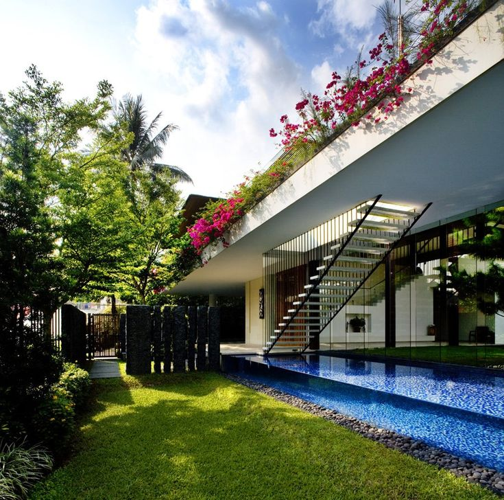 """The Tangga House is another Singapore's dream home designed by Guz Architects. Completed in 2009, the 7,663 square foot residence is located in Holland Village, an elite district of Singapore that is famous amongst the expatriate community. The luxury single-family home gives the owners the opportunity to live in harmony and comfort with nature, in Singapore's hot tropical climate. Tangga House by Guz Architects: """"The house is a contemporary interpretation.."""