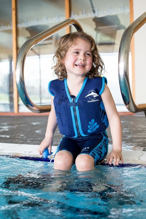 Our surfer dude model wearing Konfidence's Original Buoyancy Jacket, which colour coordinates with our Warma Wetsuit for children aged 2-7 years (also available in pink hibiscus)