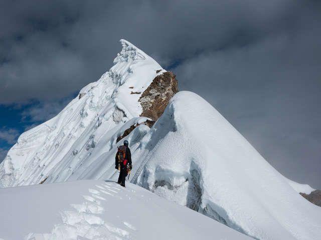 Mountaineer Standing On Snowy Ridge Near The Lobuche Peak