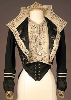 A lady's military-style black and cream wool felt bodice with contrasting embroidery and soutache trim, and silver military-style buttons;image courtesy of Charles A. Whitaker Auction Co.