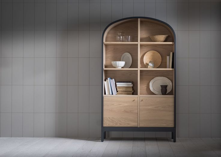 The Emil dresser features a formed curved top, open and adjustable shelving including grommets for cable management, and 2 cupboards below with shelves internally.