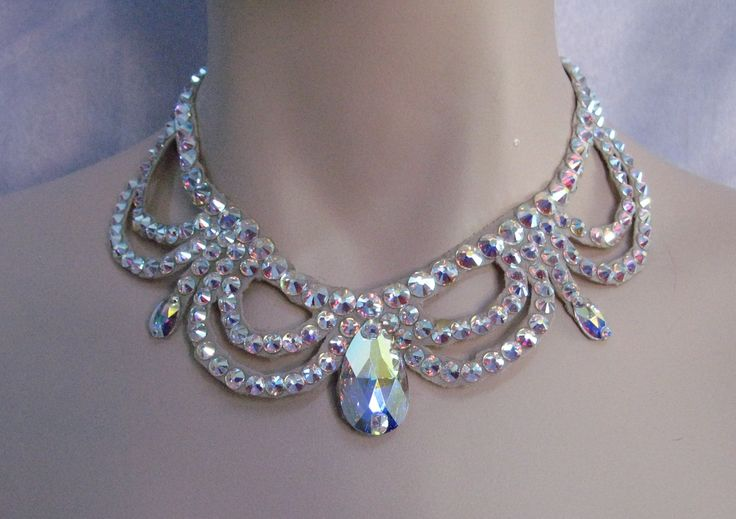 This necklace was created with Crystallized™ Swarovski Elements aurora borealisclear crystals. There is a large pear shaped stone in the front and several smaller pear shaped stones incorporated in th