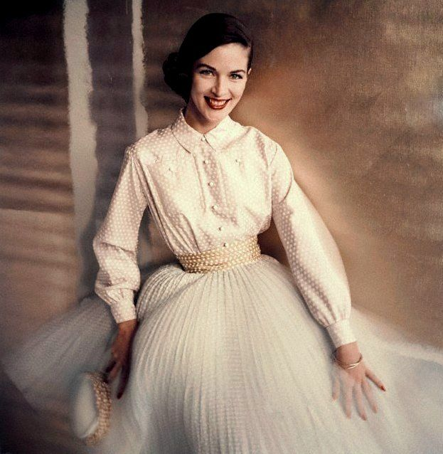 1955 Model in dress with yellow dotted cummerbund by Brigance of Sportsmaker