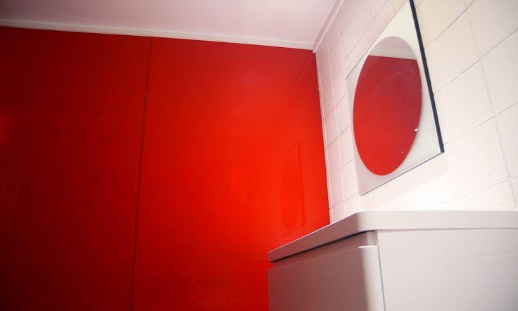 Refresh a bathroom on a budget with this super simple idea #jameshardie #bathroominspiration #redbathroom #bathroompanels