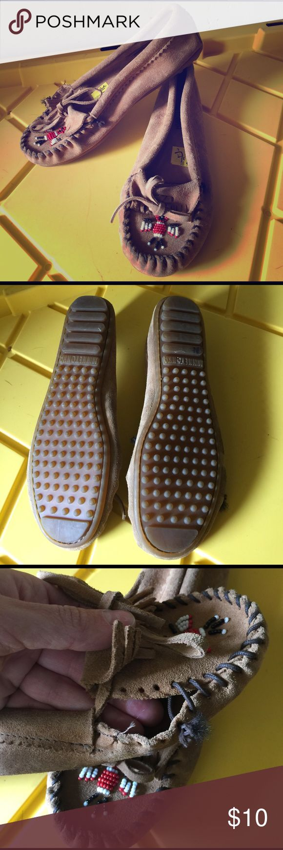 Minnetonka moccasins flats Some of the shoe is coming apart but a very easy fix if u take the time with some thread. Other than that in good condition. Minnetonka Shoes Flats & Loafers