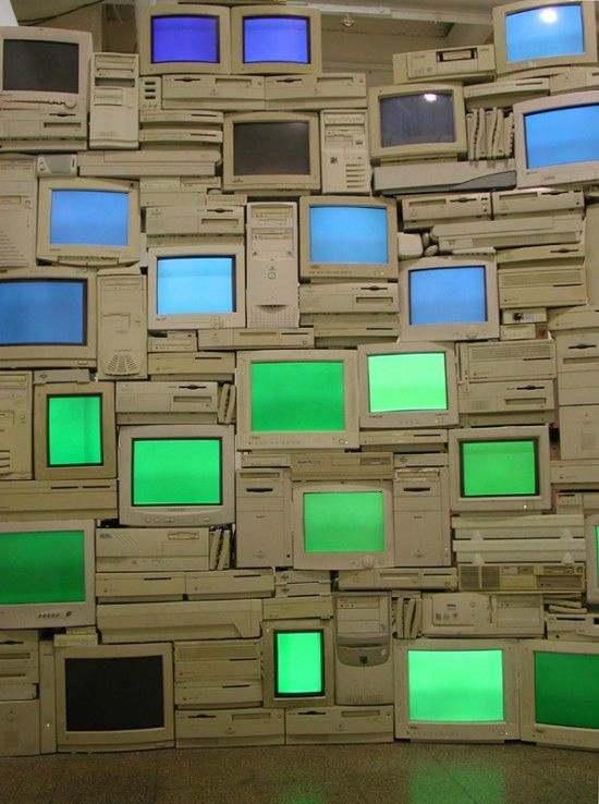 Sandy Smith started this body of work in January 2005 using a pile of broken and obsolete computer equipment she had salvaged from skips and offices.  She set about making these work again, then used them as building blocks to create various architectural structures.