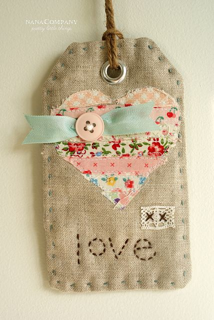 one Pinner suggested using Christmas Colors and I think you could take it beyond to all seasons and events by just changing up the colors and shape of the embellishment....also think you could add names...fabric tag love by nanaCompany, via Flickr