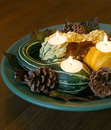 Use fall leaves and gourds to create colourful tea light holders, napkin rings and place cards