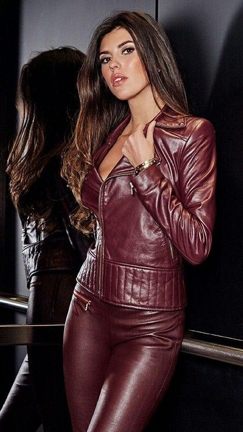 Sexy brunette in maroon leather jacket and leather ...