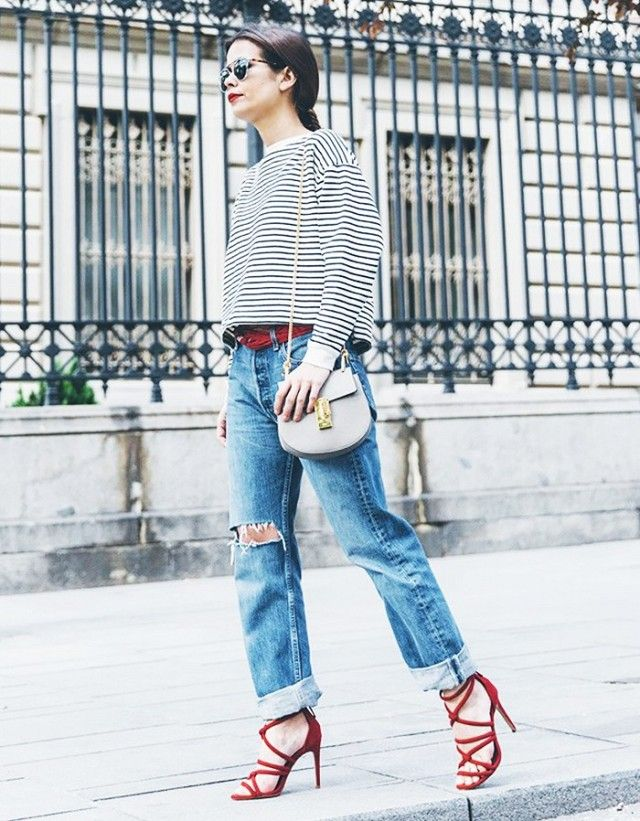 Boyfriend jeans are belted with a scarf and paired with a striped top, red strappy heels and a Chloé Drew Bag.