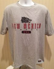 """New Mexico Lobos Retro T-shirt.  • Length: 29""""-29.5""""  • Width: 23""""-24""""  • Size: XL  • Material: 90% Cotton 10% Polyester  • Made in: USA  • Made by: Jansport   • Condition: Excellent Condition. Shirt says """"XXL"""" size on the tag actually says """"X-Large"""".  #MarchMadness #CollegeBasketball #NewMexico #Vintage #Lobos"""