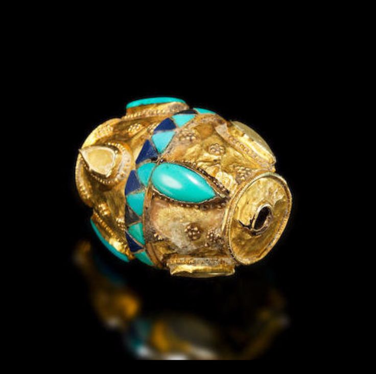 An Achaemenid gold, turquoise and rock crystal bead, dated to the 5th-4th centuries BCE. Image from Bonhams.