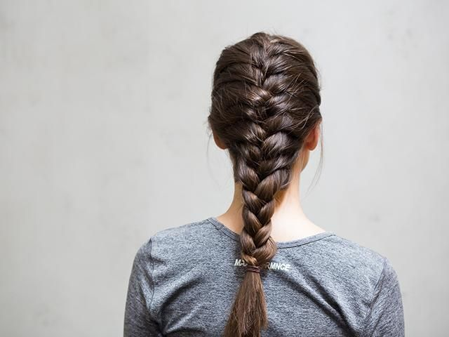 Brunnette-plait- the best gym hairstyle for boxing- womens health