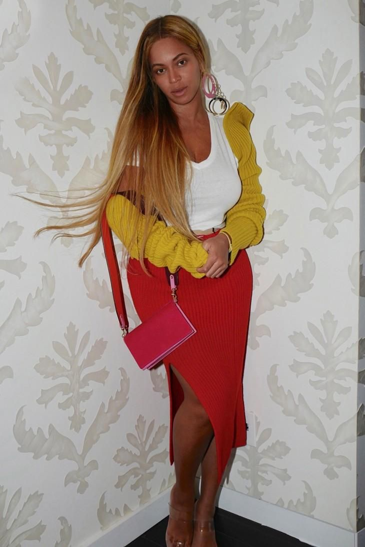 Beyonce looking sexy in her red midi skirt by Calvin Klein