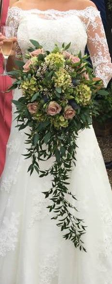 Long cascade bouquet of hydrangea, roses, waxflower, soft Italian ruscus and populus berries