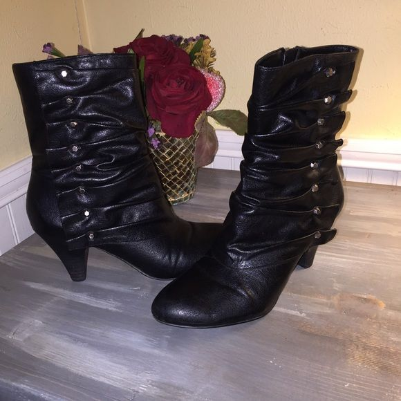 Carlos by Carlos Santana Boots Size 9 Very gently used Carlos by Carlos Santana boots. These are black with a pretty ruching/ruffling up the side. Side zipper for easy wear. Excellent condition from smoke free home. Carlos Santana Shoes Heeled Boots