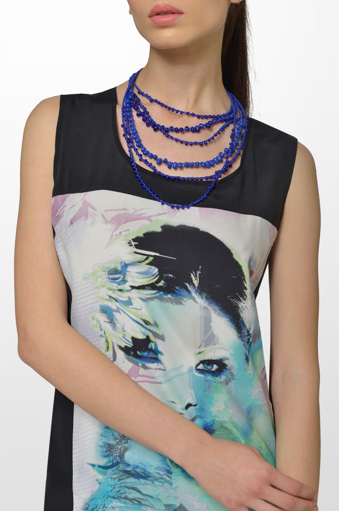 Sarah Lawrence - sleeveless printed dress, beaded necklace.